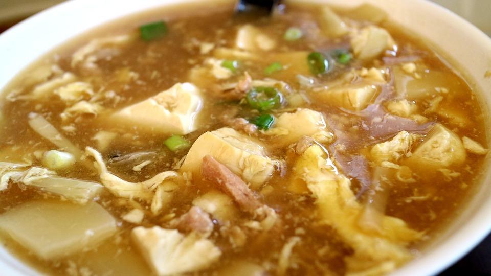 年末年始のカニ料理 カニスープと豆腐と大根のぞうすいの画像